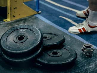 Bumper plates in their natural habitat - spread all over the floor of the gym