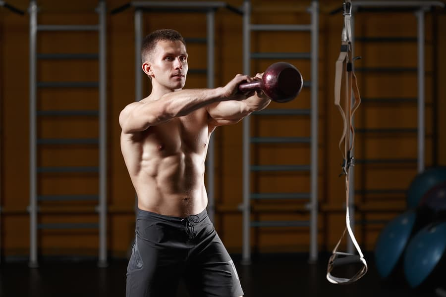 Man using a kettlebell for a kb swing