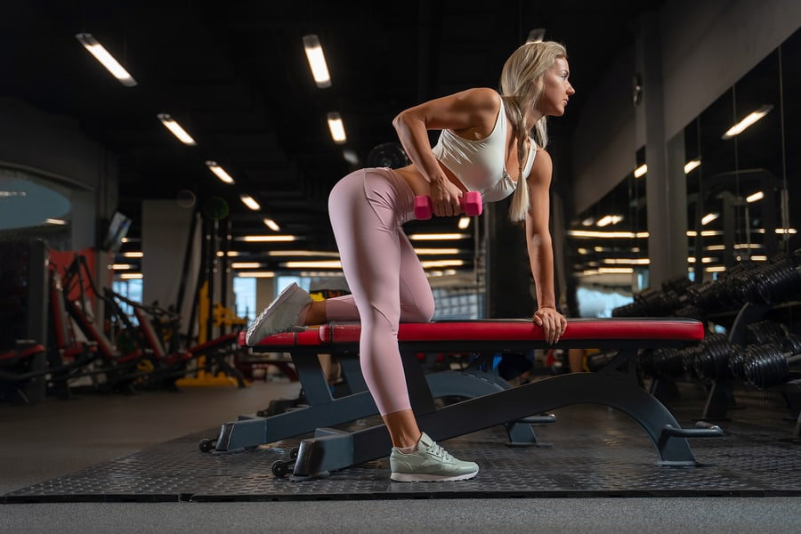 The bench used in the bench press also makes a great support for one arm dumbbell rows.