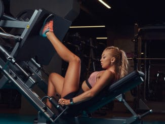Woman performing the single leg (unilateral) leg press