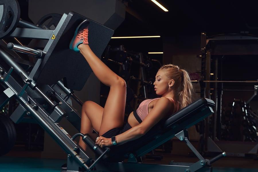 Woman performing the single leg (unilateral) leg press