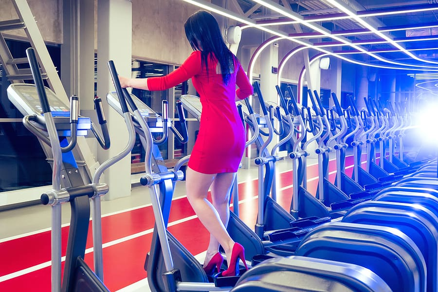 Women working out in the gym in a dress