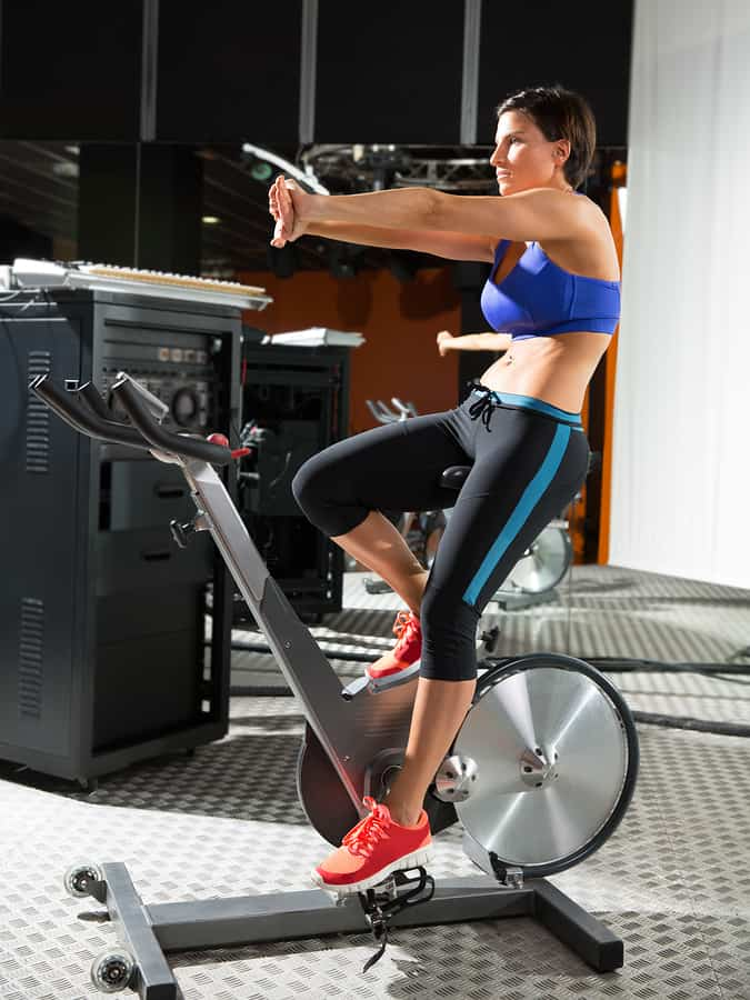 Woman on a spin bike in the gym